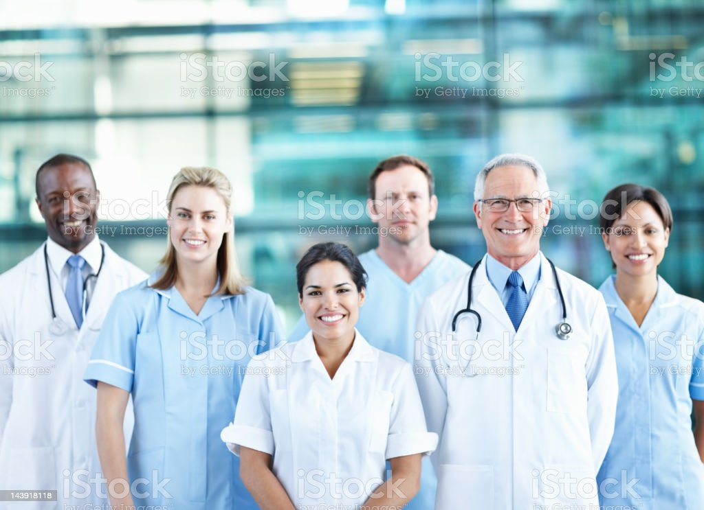 Team of successful doctors smiling together royalty-free stock photo