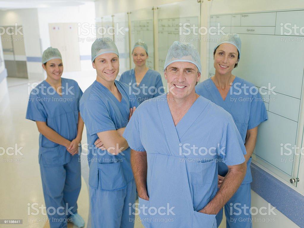 Team of surgeons in hospital corridor royalty-free stock photo