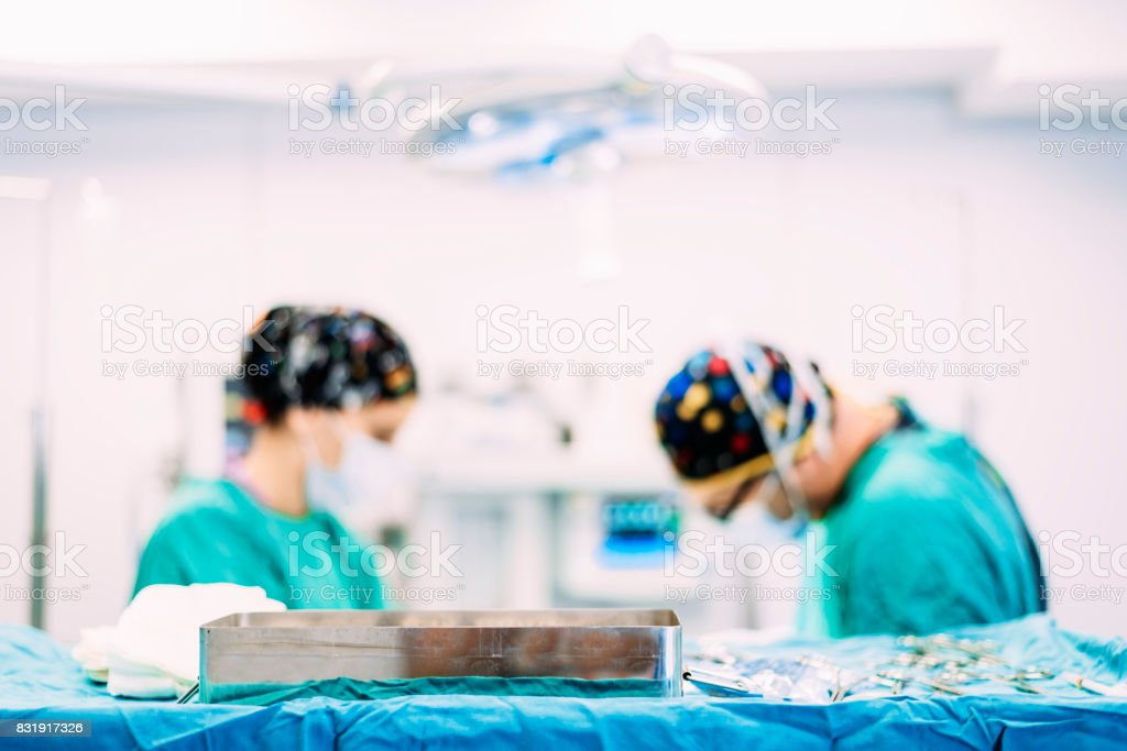 Team of Surgeons Operating in the Hospital. stock photo