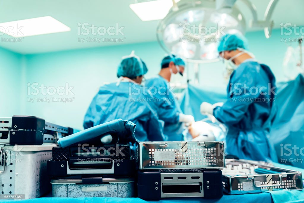 Team of Surgeons Operating. stock photo