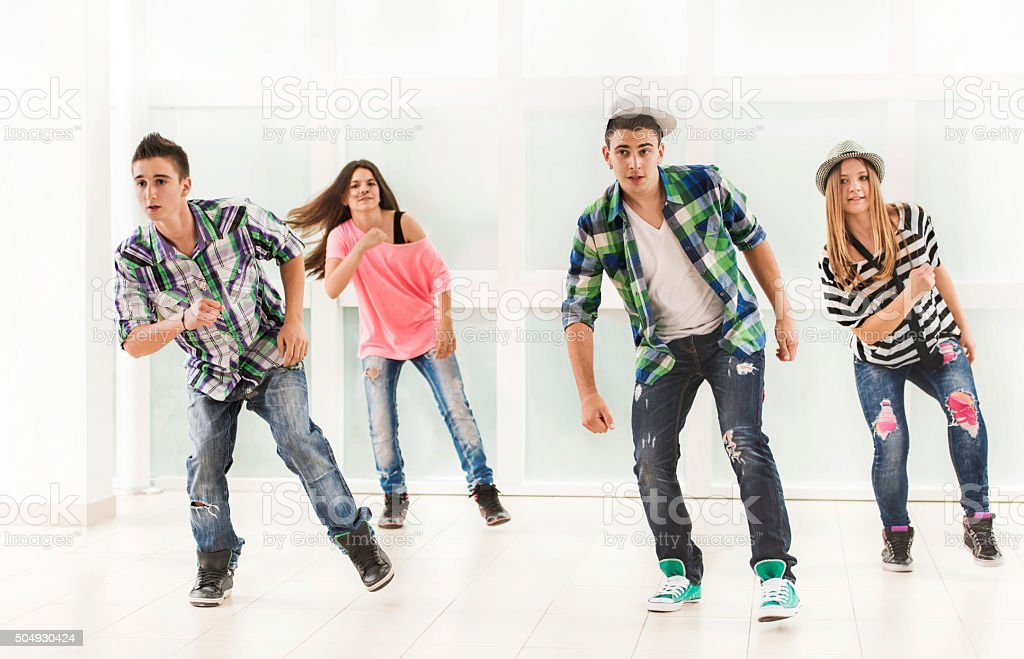 Team of teenage hip hop dancers during exercising. stock photo