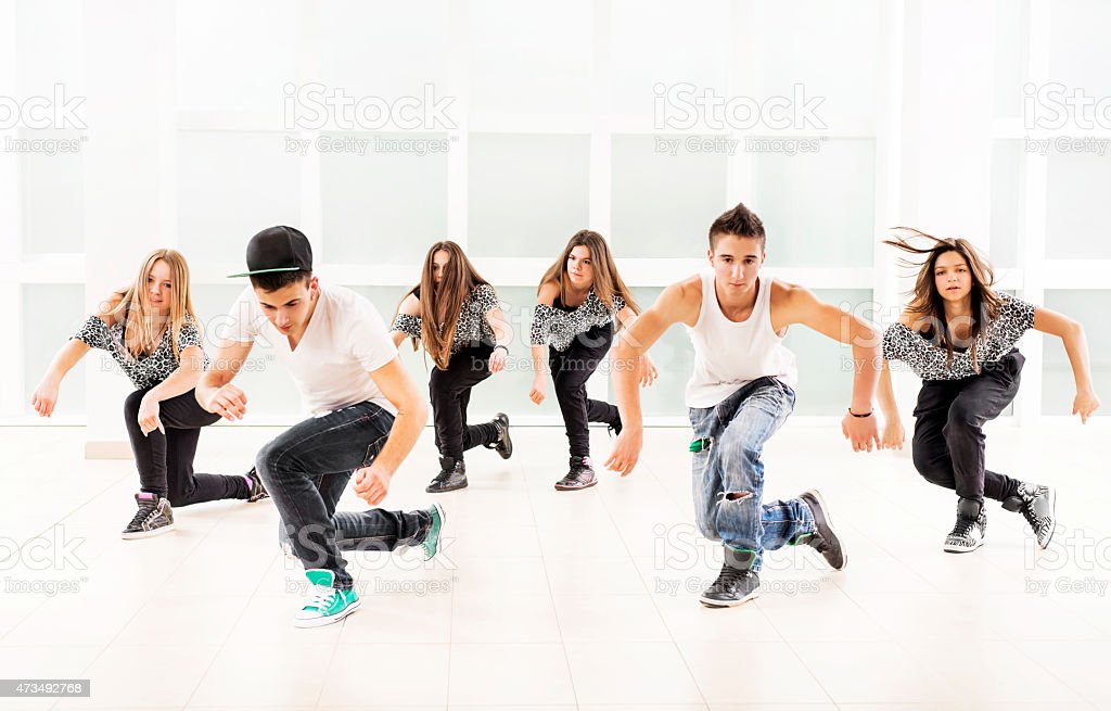 Large group of teenagers practicing modern dancing.