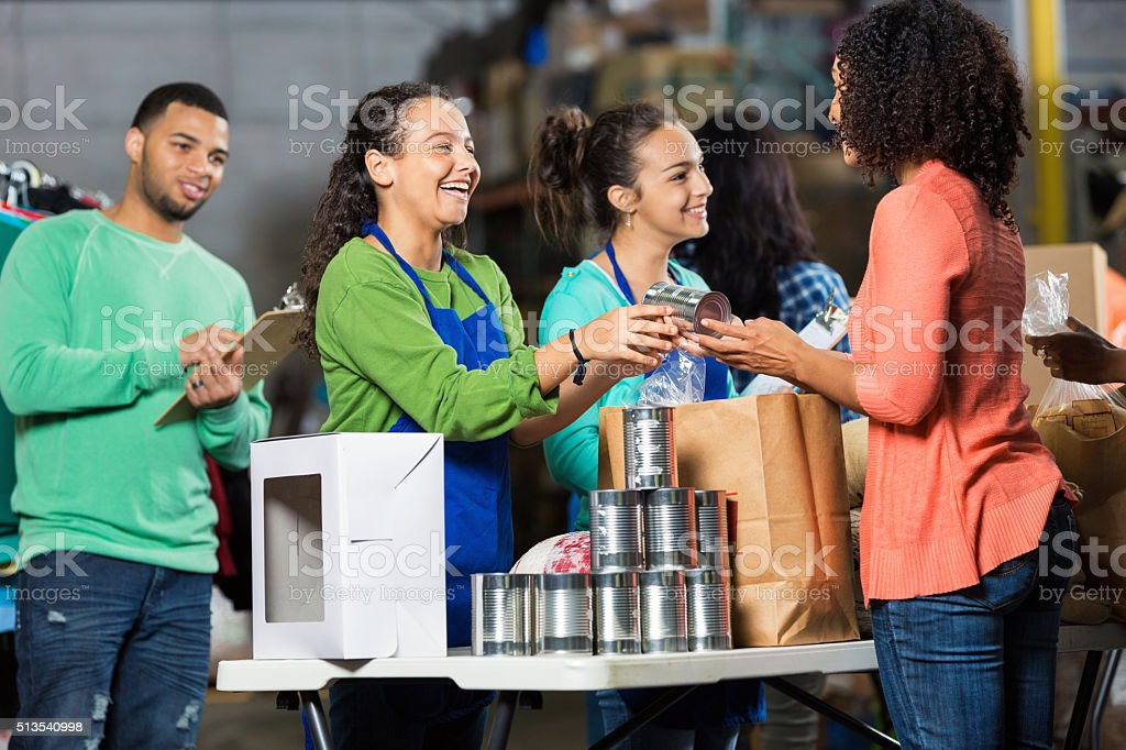 Team of volunteers receive donated items stock photo