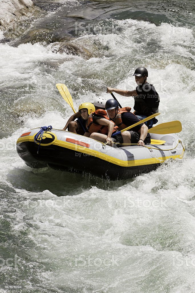 Team of Whitewater Rafters Going Down a River royalty-free stock photo