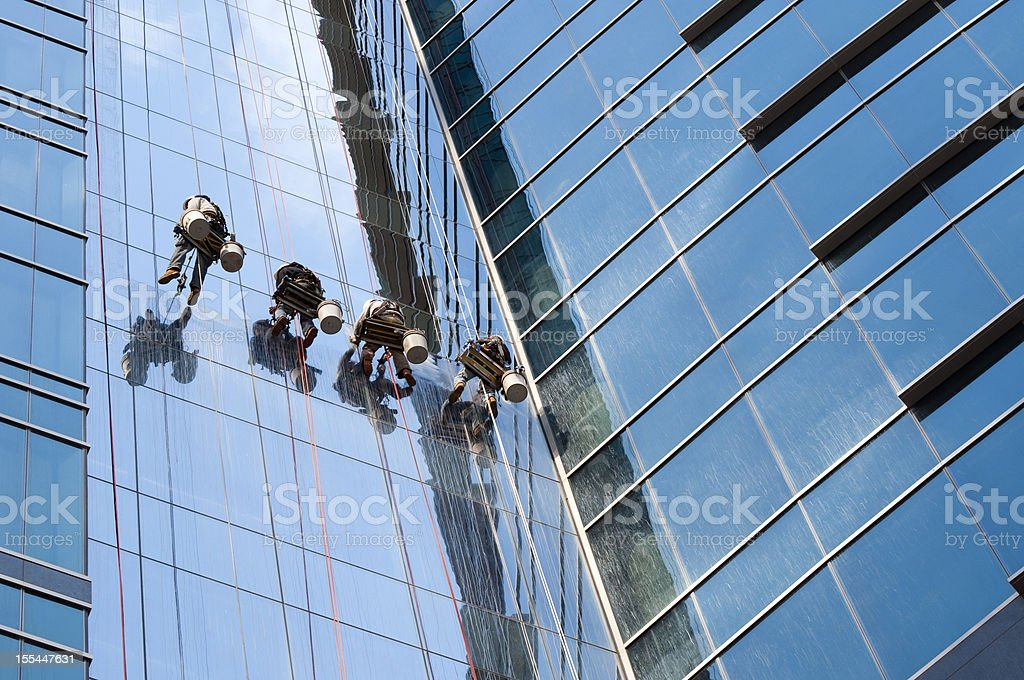 Window washer team cleaning high rise exterior stock photo