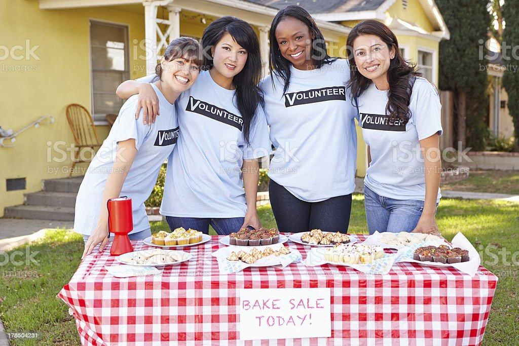 Team Of Women Running Charity Bake Sale stock photo