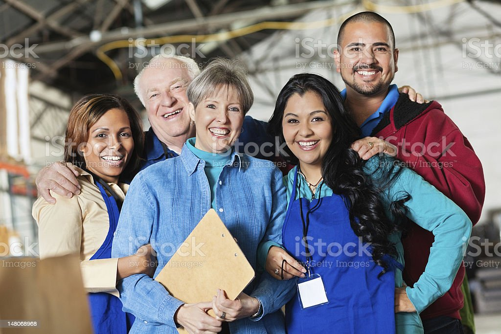 Team of workers at a donation facility royalty-free stock photo