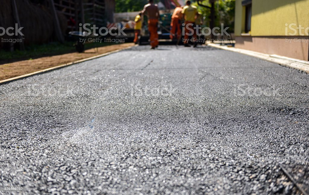 Team of Workers making and constructing asphalt road constructio stock photo