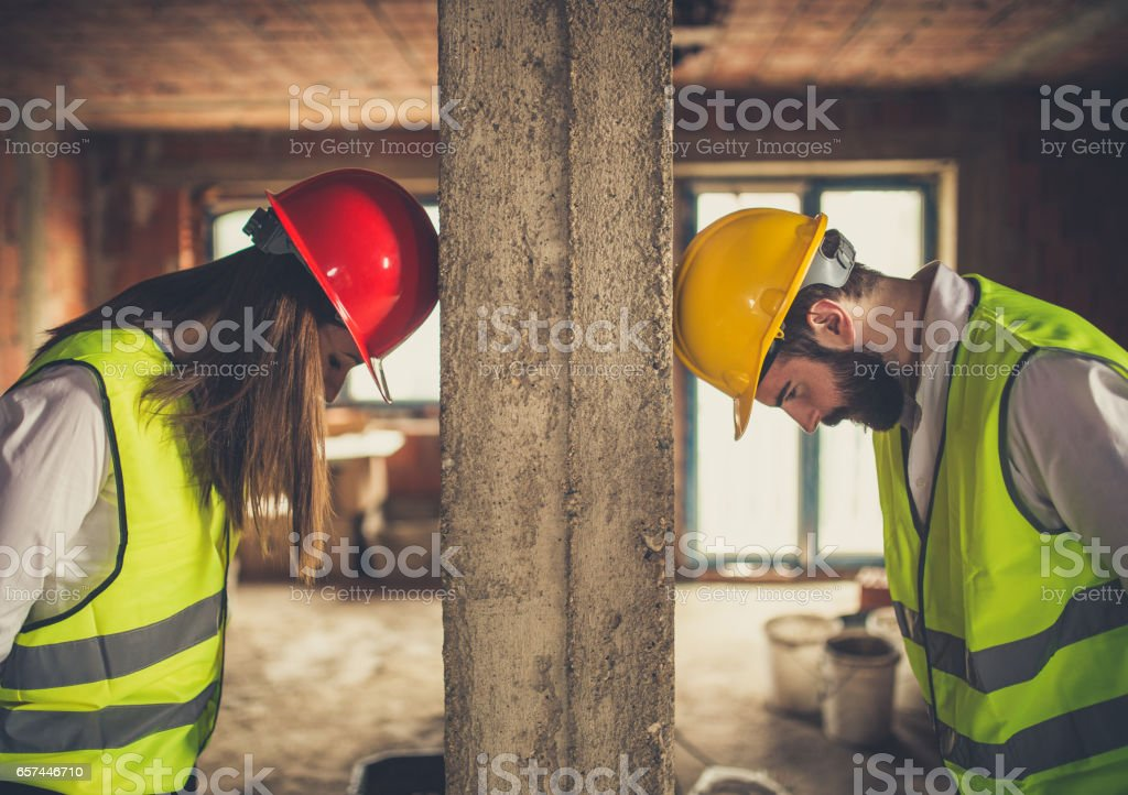 Team of young architects trying to solve a problem stock photo