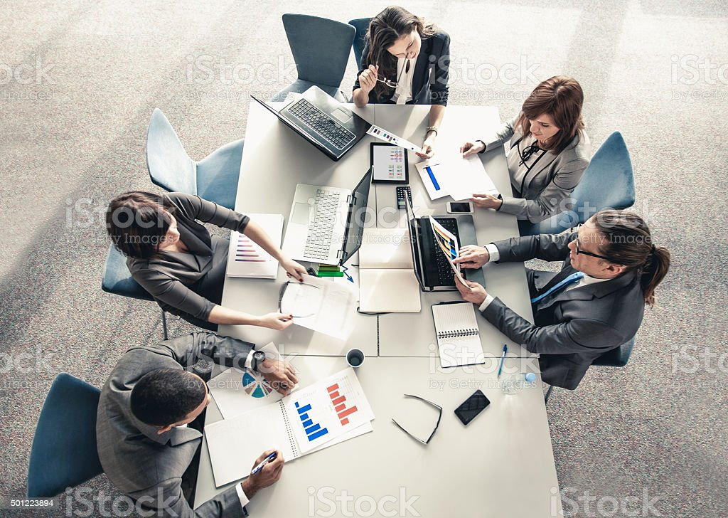 Team of young business people having meeting stock photo