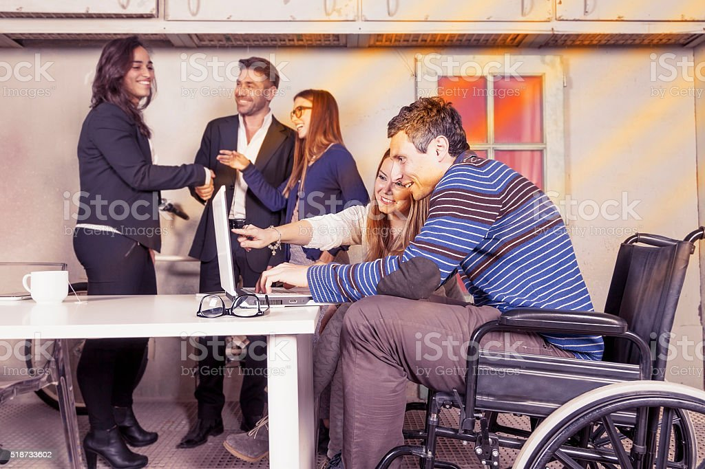 team of young businesspeople working together stock photo