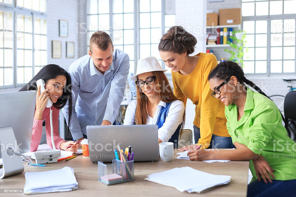 Team of young coworkers discussing ideas in modern office stock photo