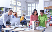 Team of young people working at workplace