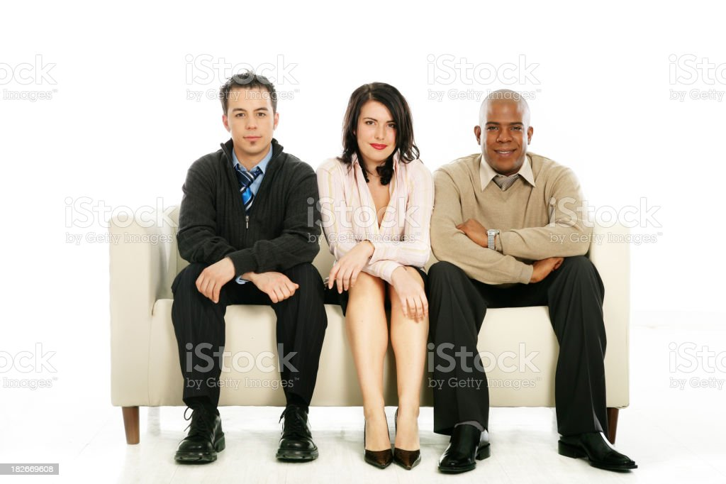 Team posing on a couch royalty-free stock photo
