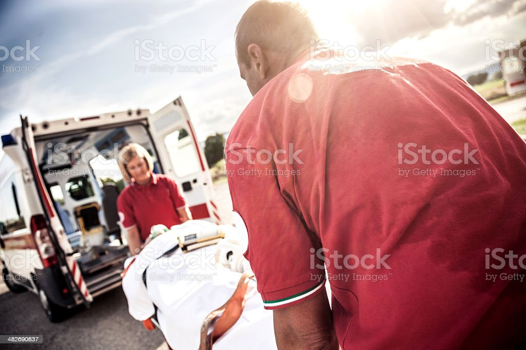 EMT team provide first aid on the street royalty-free stock photo
