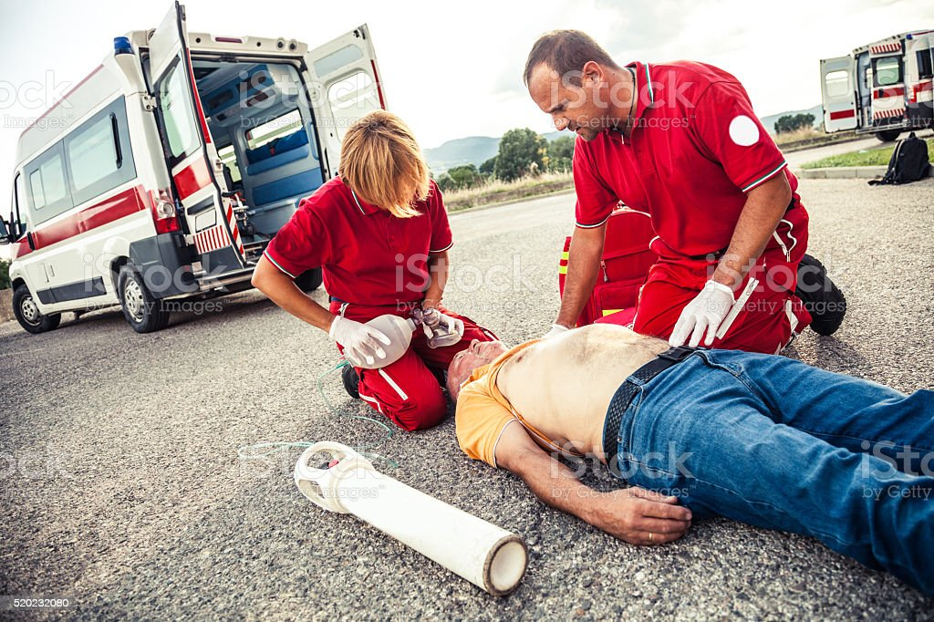 EMT team provide first aid on the street stock photo