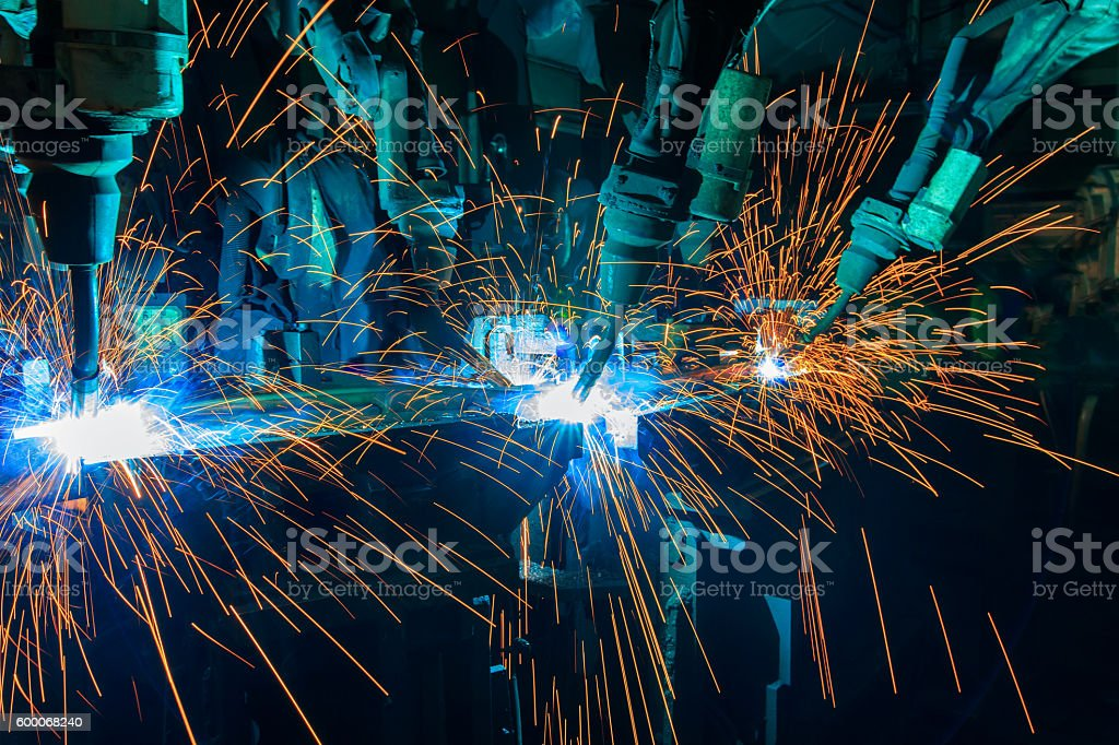 Team robot welding stock photo