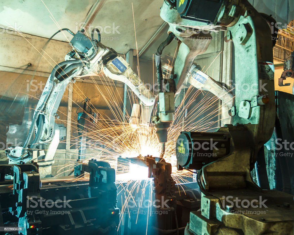 Team robot welding steel motion blur industry. stock photo
