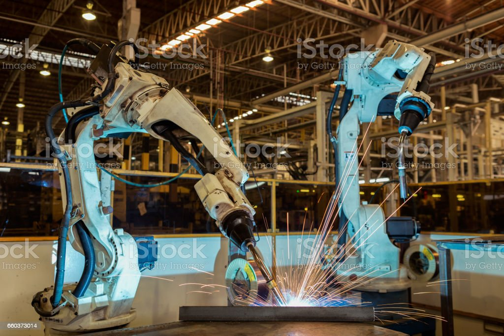 Team robots are test run welding  in car factory stock photo