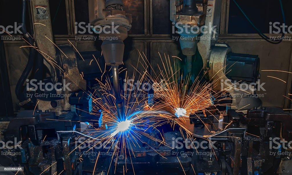 Team robots welding in factory stock photo