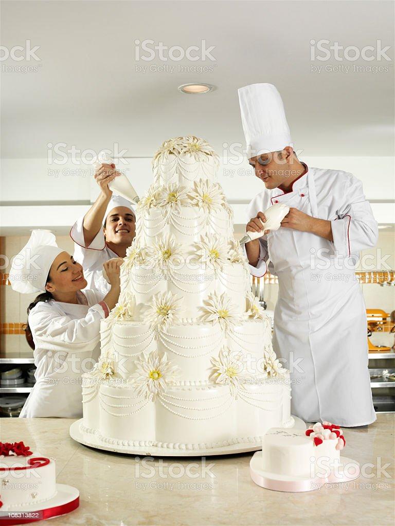 Team spirit in pastry stock photo