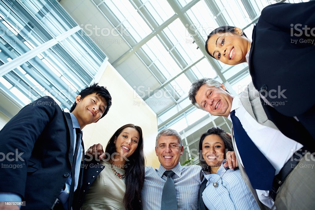 Team supporting their boss and smiling royalty-free stock photo