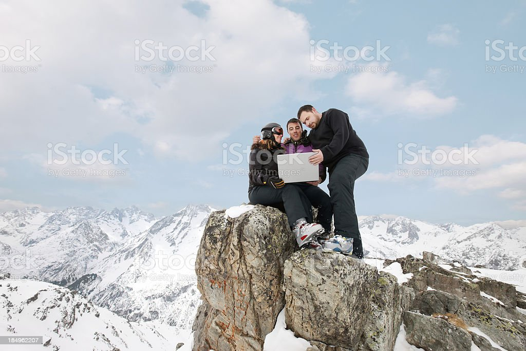 Team  with a laptop on the top stock photo