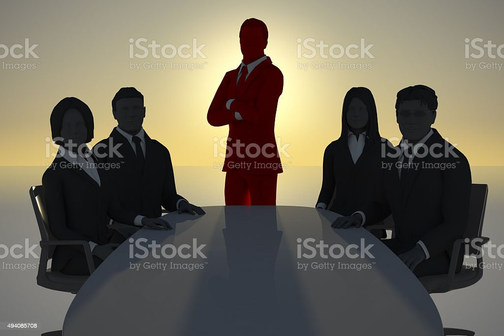 Team with leader meeting at sunset at a conference table stock photo