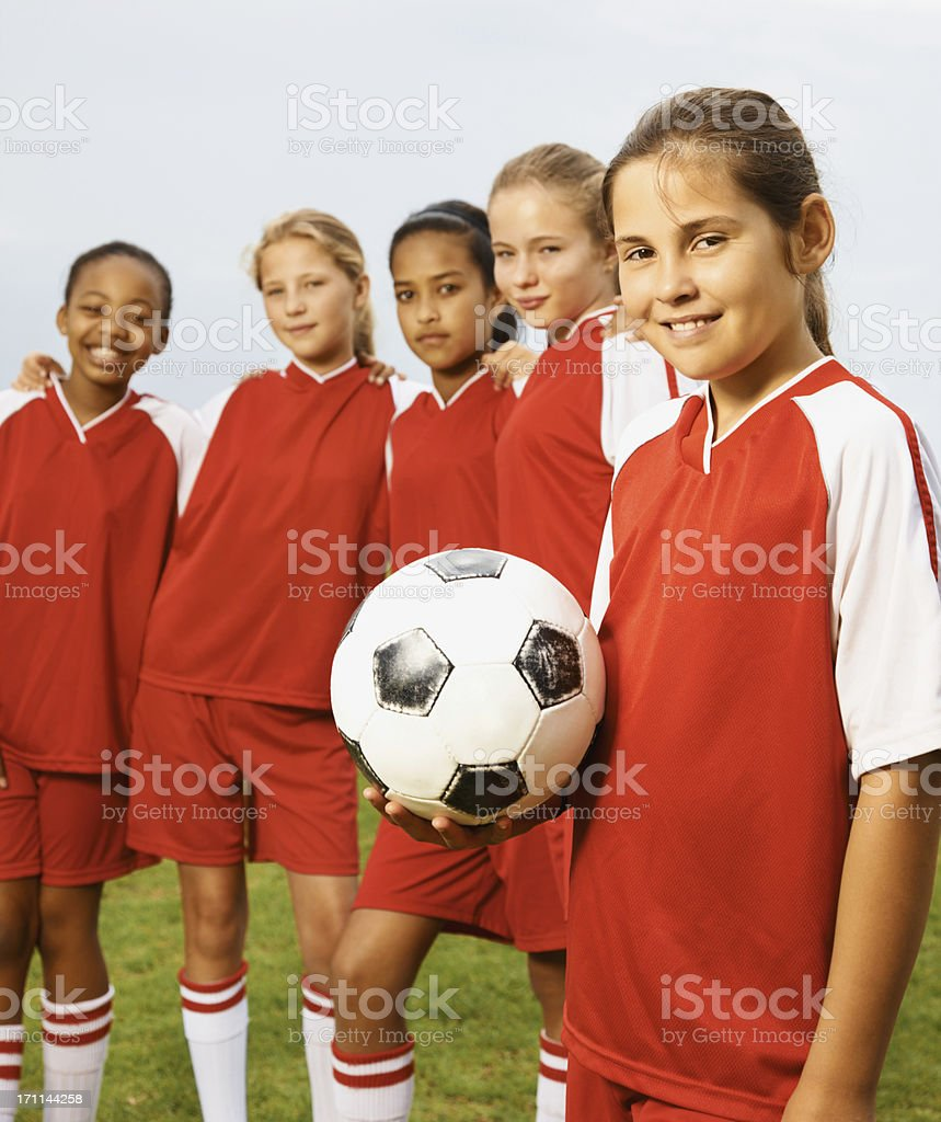 Team with their captainholding a soccer ball royalty-free stock photo