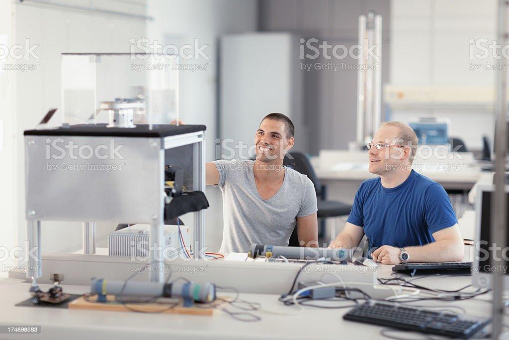team work engineering laboratory stock photo