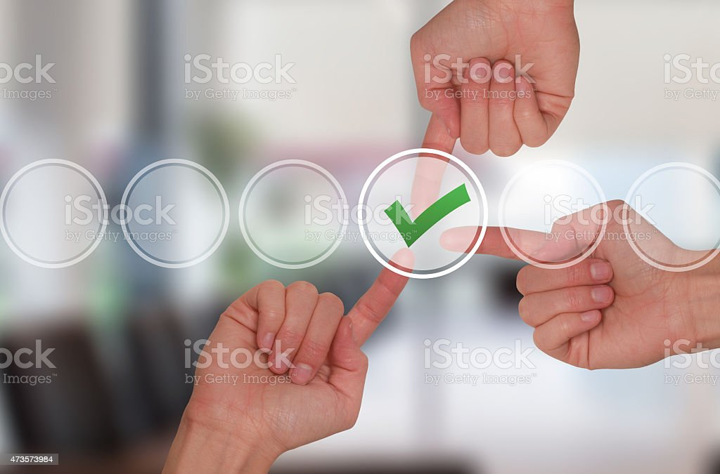 Team work hands touching check mark on virtual screen stock photo