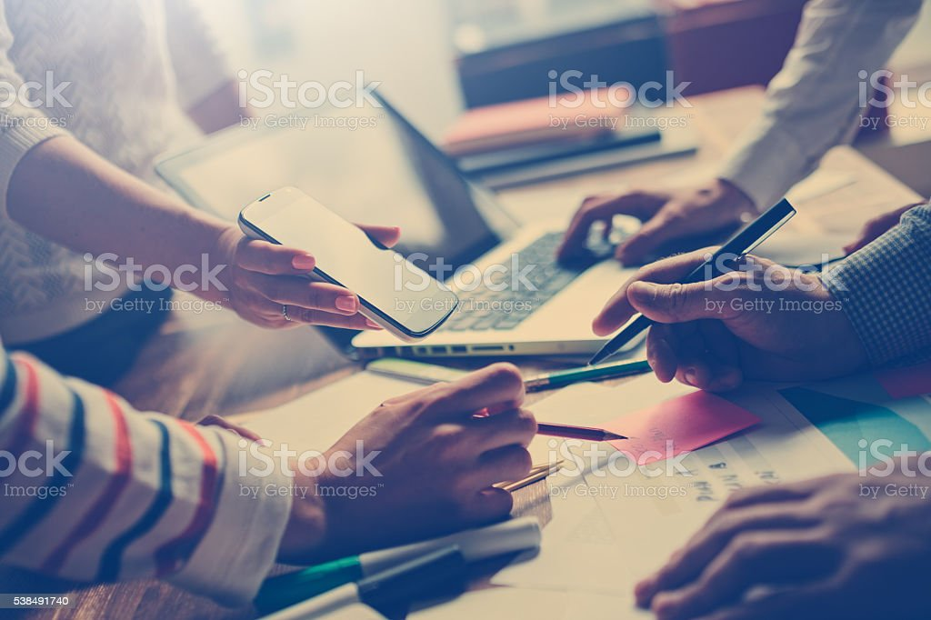 Team work process. Managers discussing new project stock photo