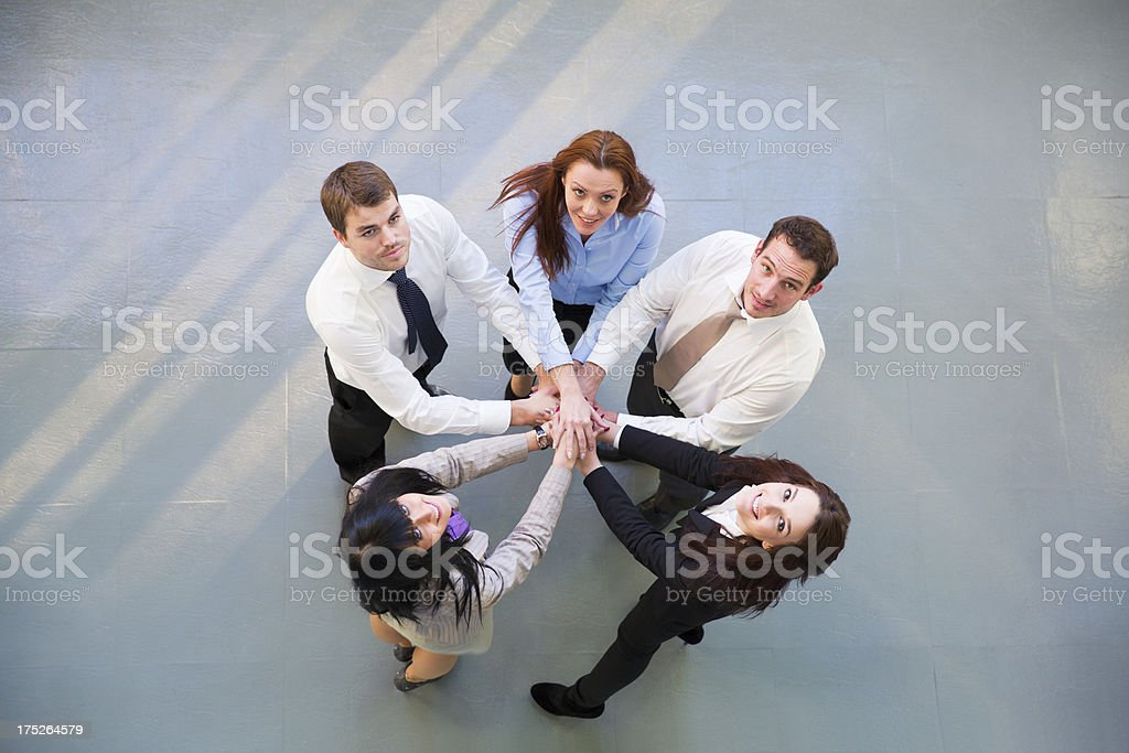 Team work....business people showing unity,looking up royalty-free stock photo