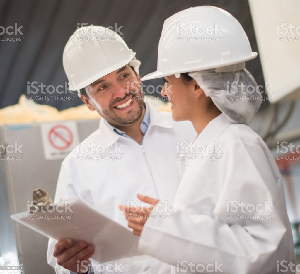 Team working at a factory stock photo