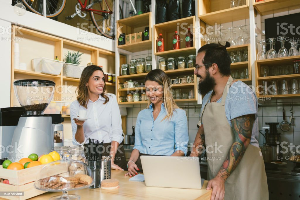 Team Working In  Smoothie Cafe stock photo