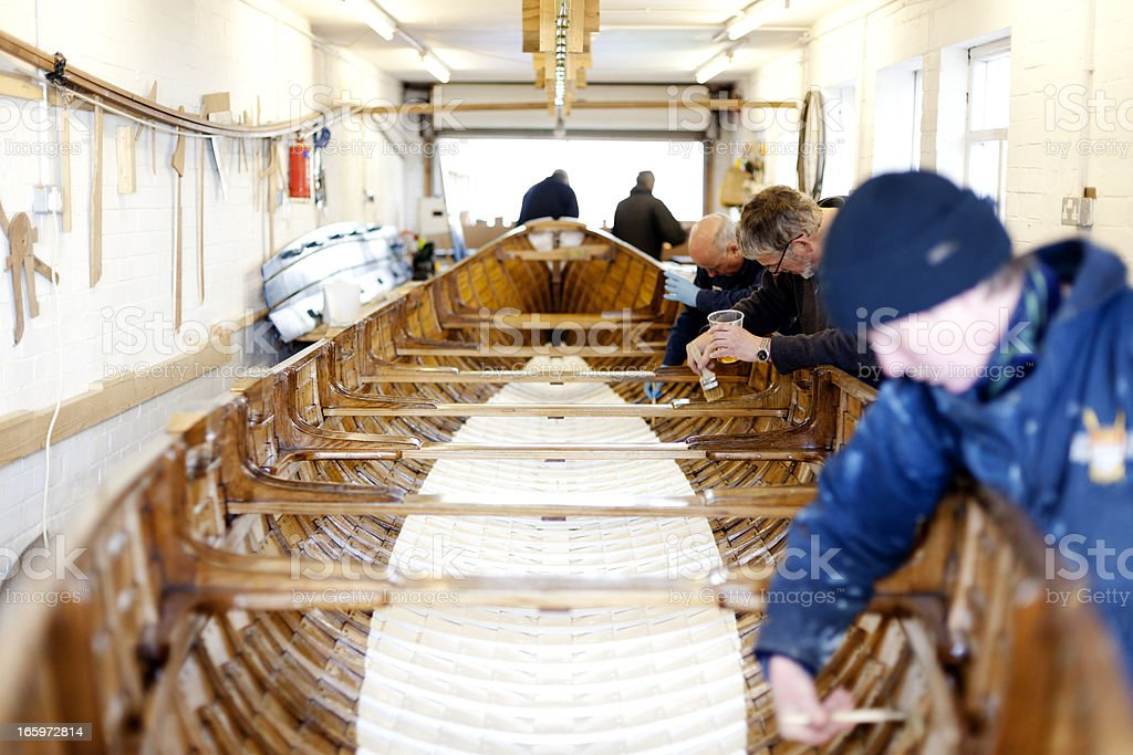 Team working on a gig boat stock photo