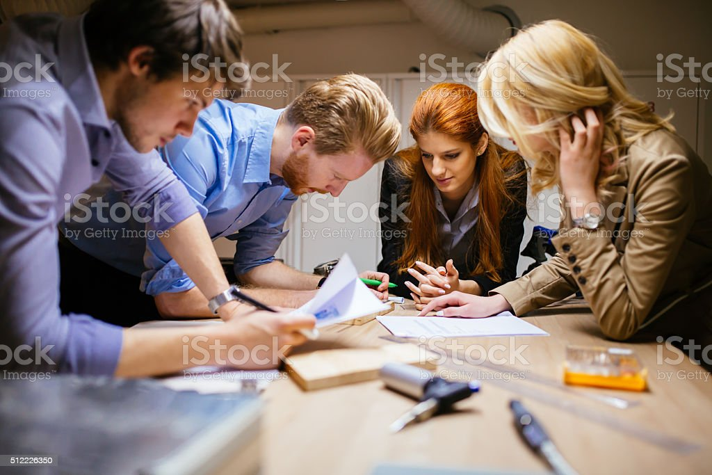 Team working on project together stock photo
