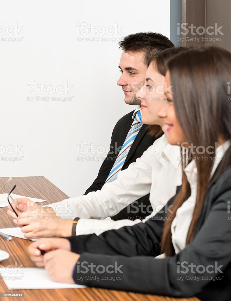 Teammates focused on the negotiations stock photo