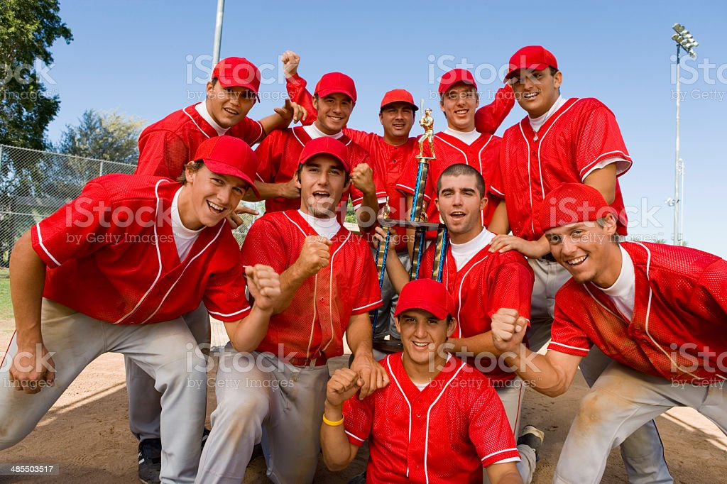 Teammates Holding Trophy stock photo