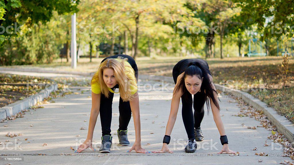 Teammates training for a running competition stock photo