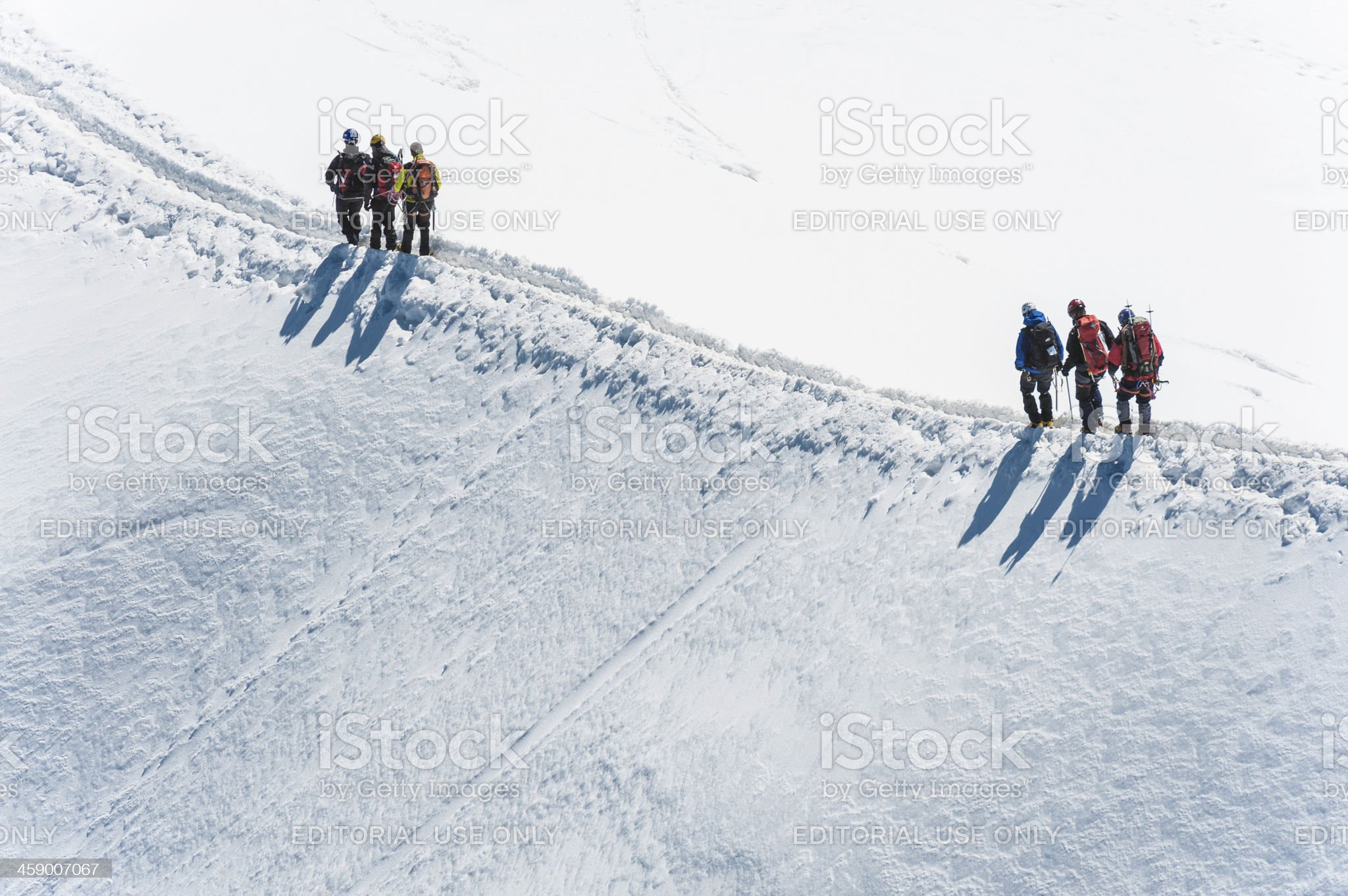Teams of mountaineers snowy ridge Alps royalty-free stock photo