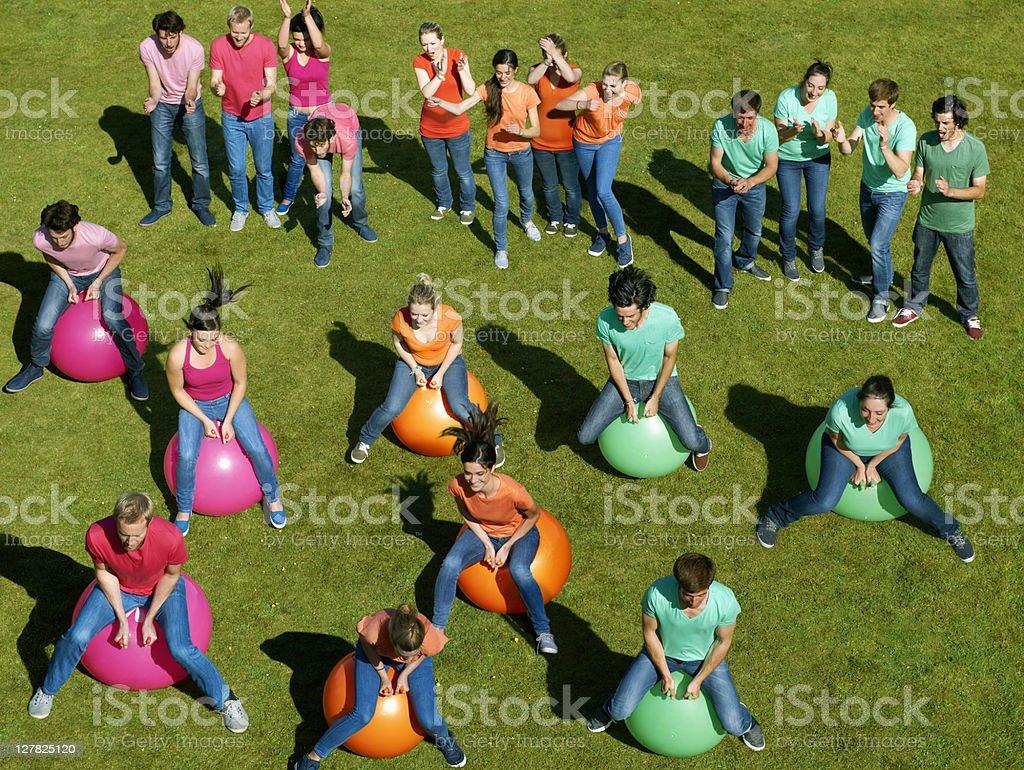 Teams racing on exercises balls royalty-free stock photo