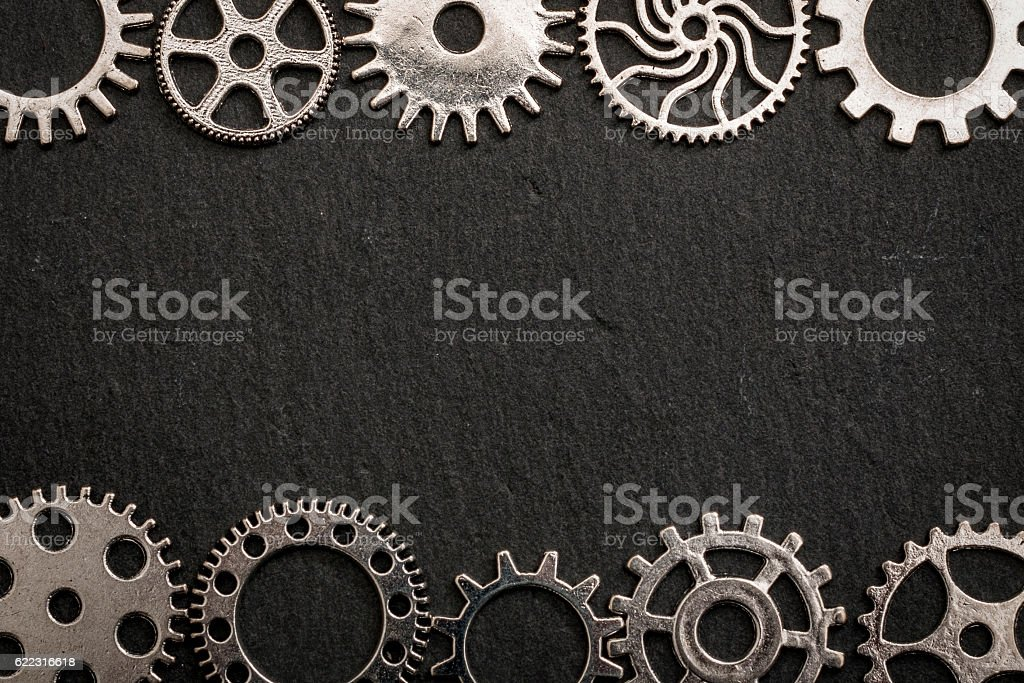 Teamwork and bonding concept with metal gears interlocked with copy space stock photo