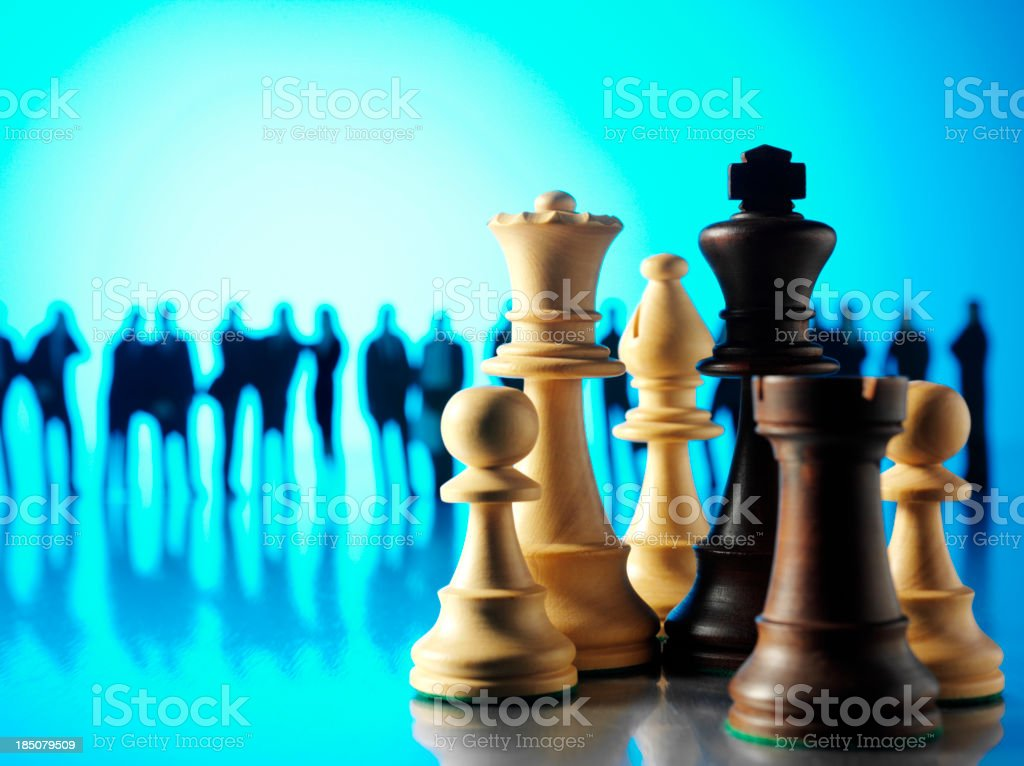 Teamwork and Chess Pieces stock photo