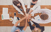 Teamwork and teambuilding concept in office, people connect hand