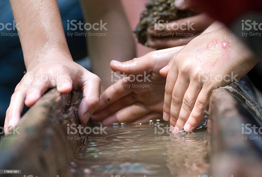 teamwork children hands building barrage dam royalty-free stock photo