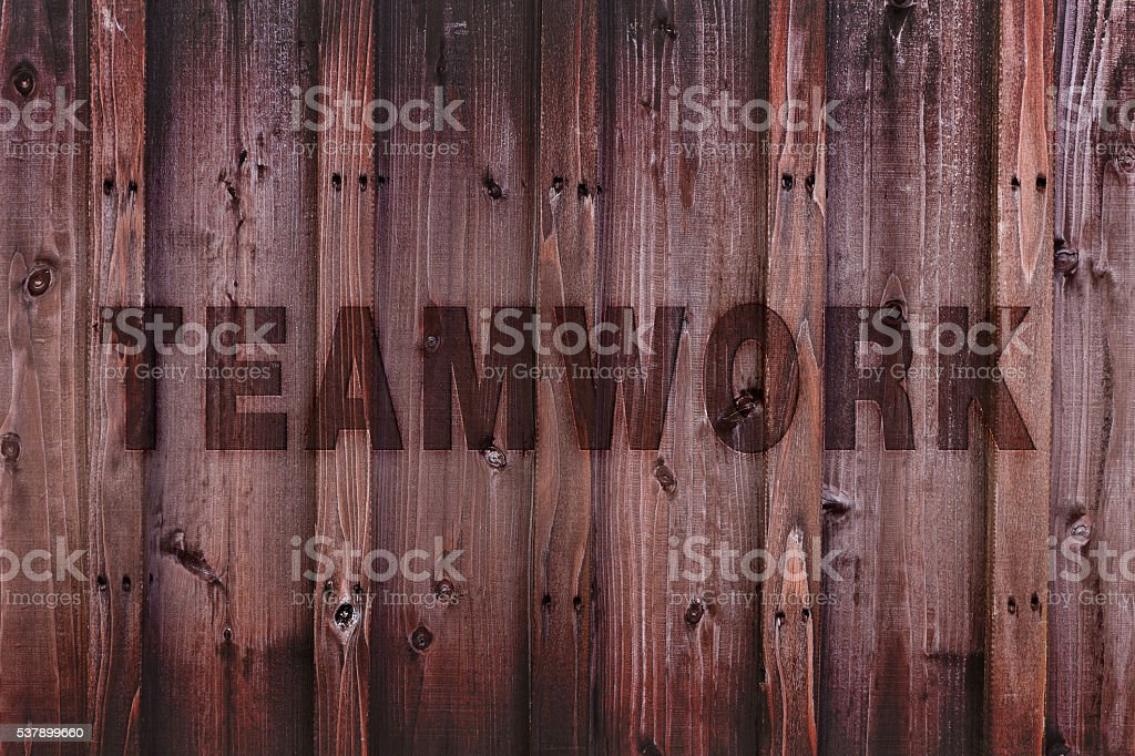 Teamwork Concept Background / Teamwork Word Engraved on Wood stock photo