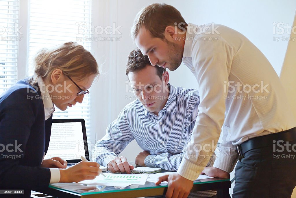 teamwork concept, people in the office on business meeting stock photo
