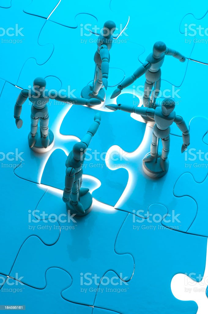 Teamwork concept with wooden figures royalty-free stock photo