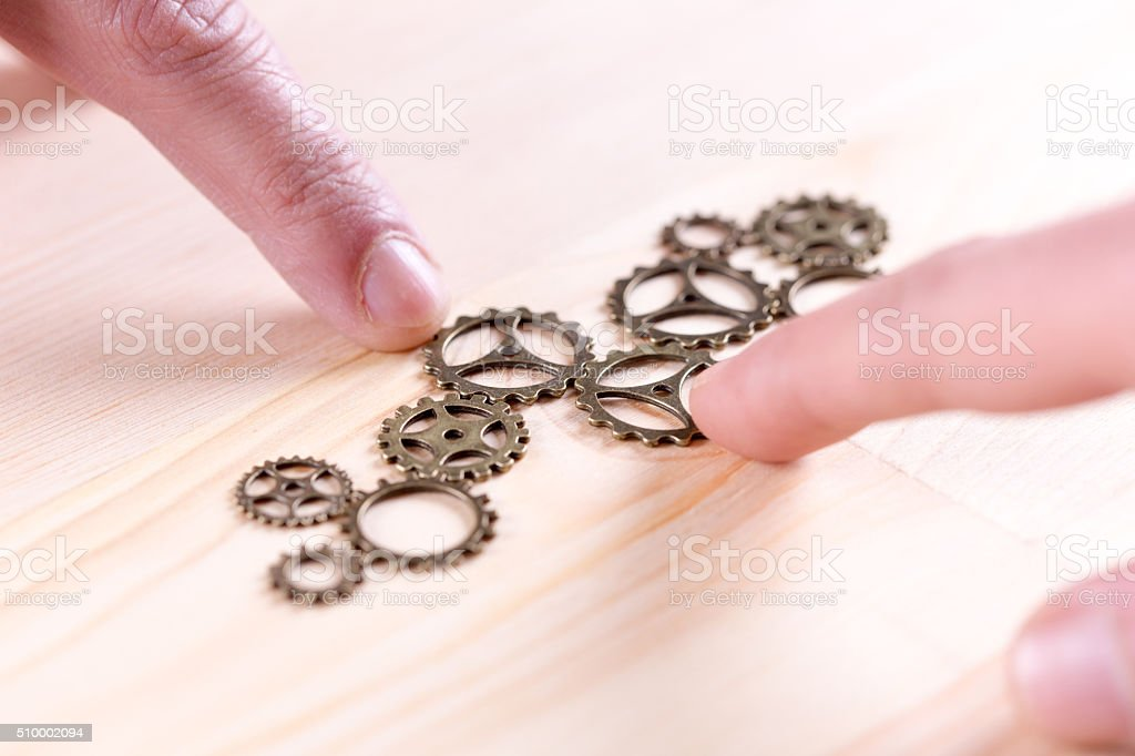 Teamwork Concept: Works together to build a gear system stock photo